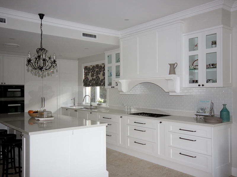 Highland Kitchens - White cabinetry for kitchen and drinks cabinet