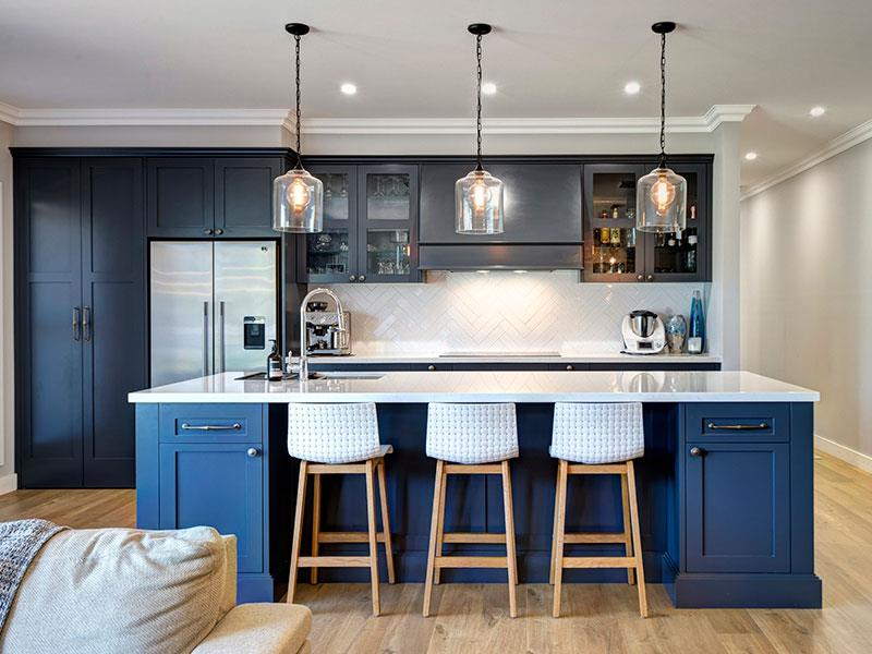 Highland Kitchens - Traditional style cabinets extending beyond the kitchen space