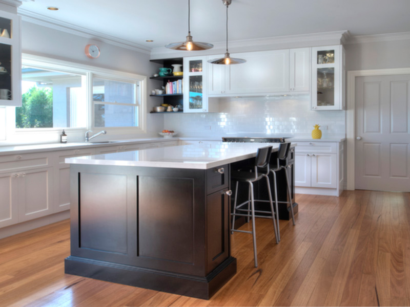 Highland Kitchens - Traditional style kitchen cabinetry bathed in light