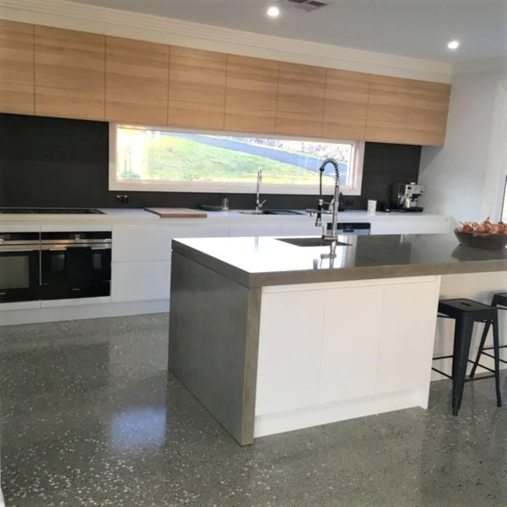 Highland Kitchens - Modern Concrete kitchen with detailed windowed backsplash